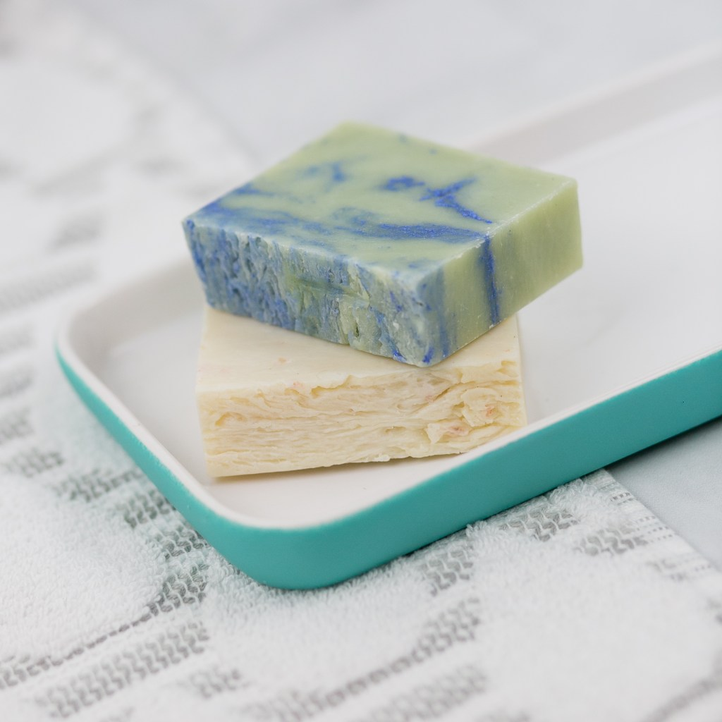 Two bars of all-natural, handmade soap.