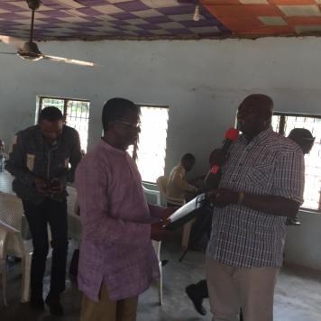 ANA President Denja Abdullahi giving a gift to the School Director,