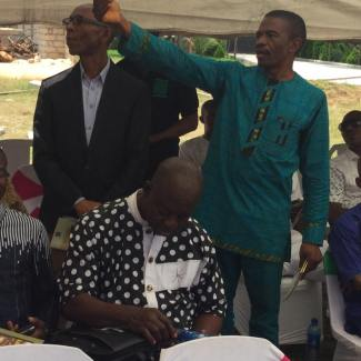 Camillus Ukah (ANA Vice Chairman and Teen Authorship Coordinator) showing Anaele Ihuoma ... (?) Then, that's John Sarpong looking down.