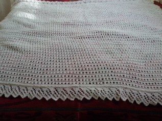 This shawl covers half a double bed