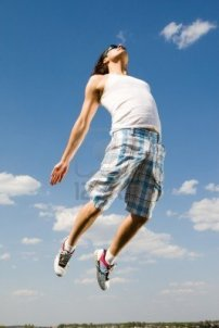 8451914-image-of-energetic-man-jumping-high-against-bright-blue-sky