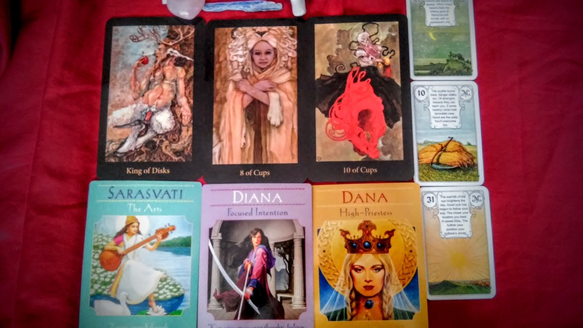 Cards from the Mary-el Tarot, Goddess Guidance, and Petit Lenormand decks.