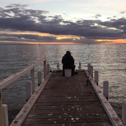 Fisherman on Jetty at Portarlington, Victoria, Australia