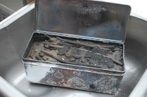 making charcoal- opening the tin