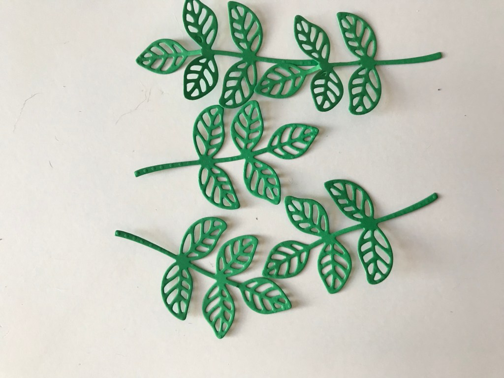 Stemmed leaves were cut out with StampinUp! die giving the leaves details.