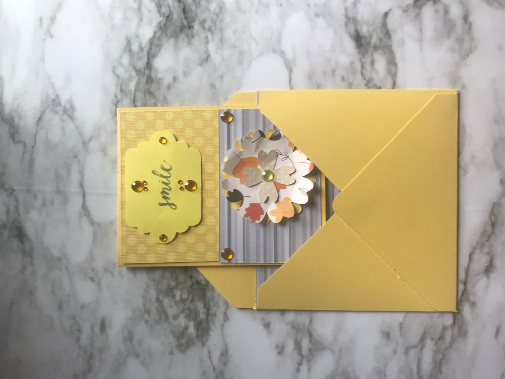 This card is made with yellow and gray cardstock. The flower was made with the Sizzix From the Heart Collection Bigz Die Flowers Layers with Heart Petals.