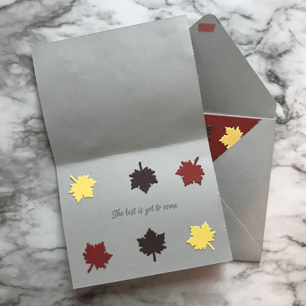 Die cut leaves decorate the inside of the card with the stamp: The Best Is Yet To Come.
