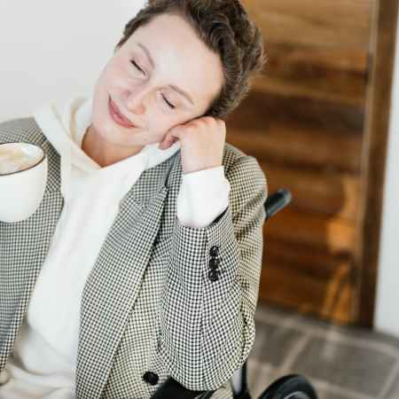 peaceful woman on wheelchair with coffee