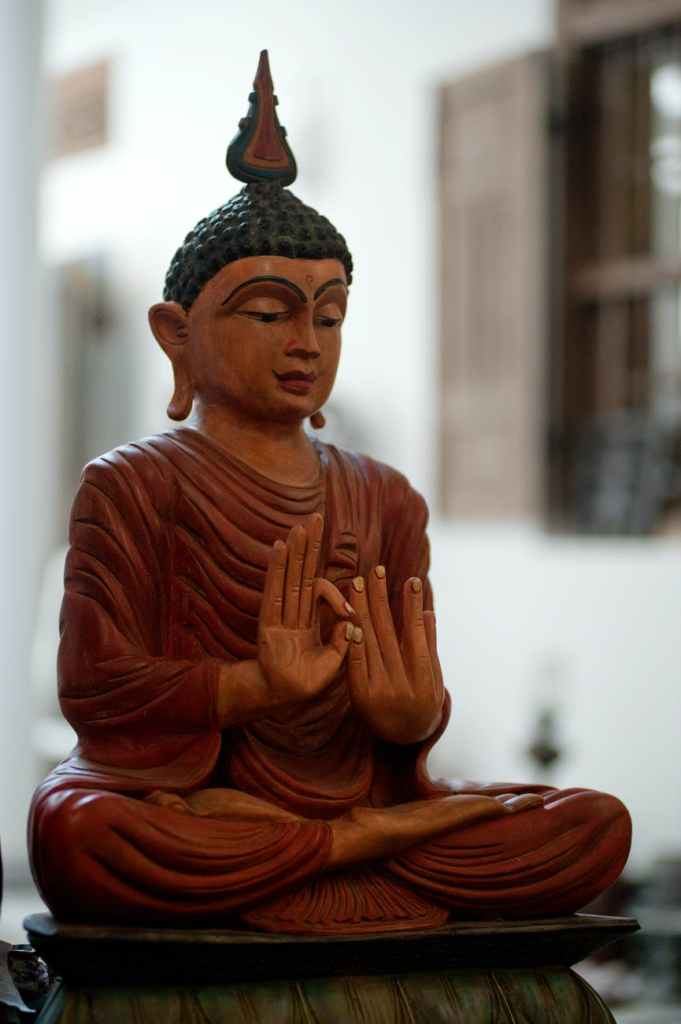 meditating buddha figurine