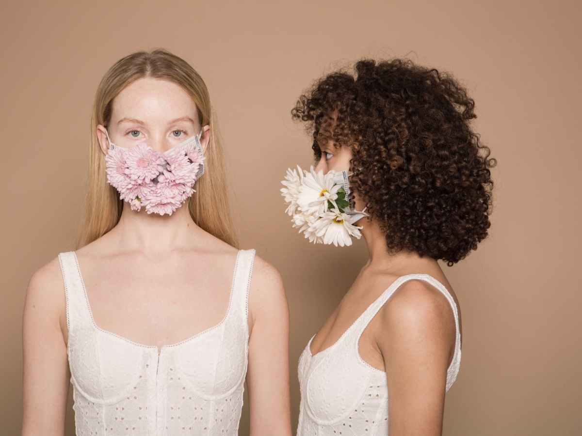 calm diverse women in flower masks