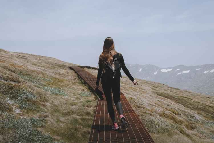 a woman hiking on a mountain