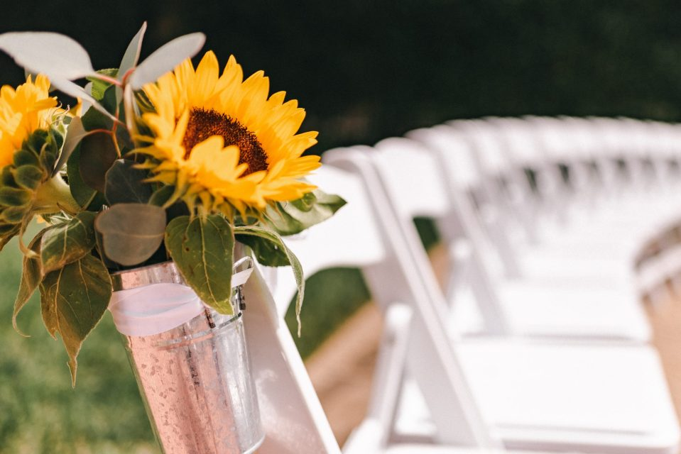sunflower-wedding-ideas-suessmoments-terrace-on-the-park-white-ceremony-chairs