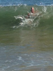 Blue Mind: Sue Thomas smacked on the back of the head by a large wave! 2013. (Photo: Carolyn Black)