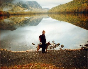 Sue and Quoddy at a lake in Maine at peak leaf season