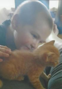 Conner Snyder with an orange kitten