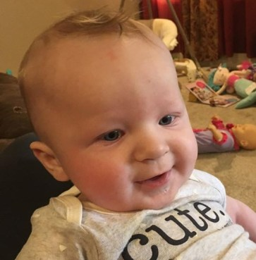 Baby Aiden Leonardo wearing a cute onesie
