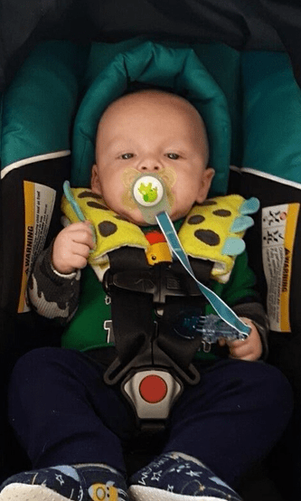 Brock Kimsey in his car seat with a pacifier