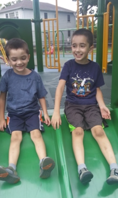 Thomas and Anthony Valva on a slide