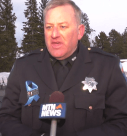 West Yellowstone Police Chief Scott Newell speaks with reporters at Sunday's vigil honoring 12-year-old Alex Hurley.
