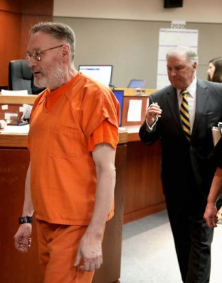 Drew Freund and attorney Henry Sugden leave the courtroom on February 27, 2020
