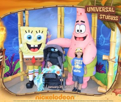 Josias Marquez and older brother with Spongebob and Patrick at Universal Studios