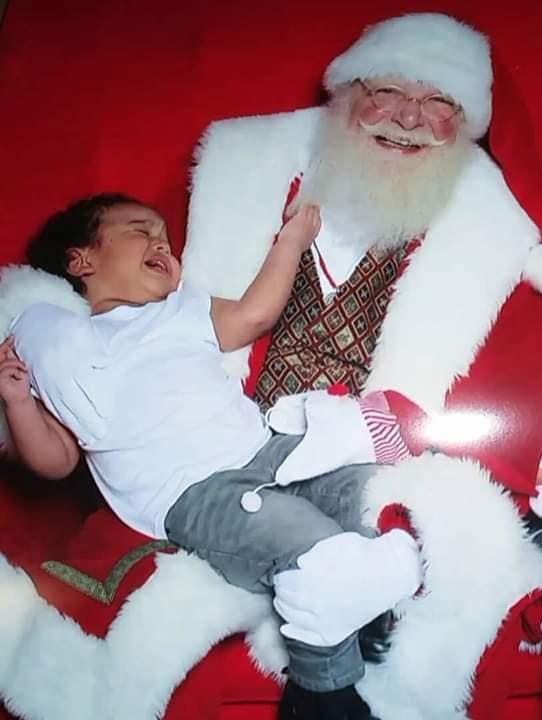 Josias Marquez with Santa