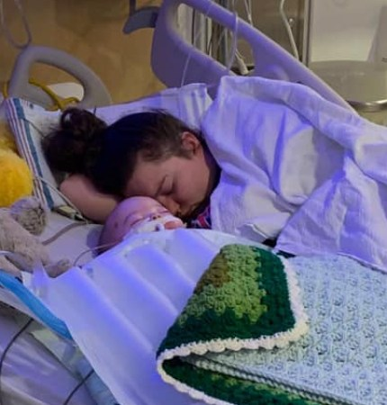 Adrien Michael Wayne Decker and Madison Tayllor Harvey in a hospital bed