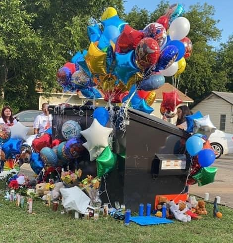 Makeshift memorial at the dumpster where Frankie Gonzales' body was discovered