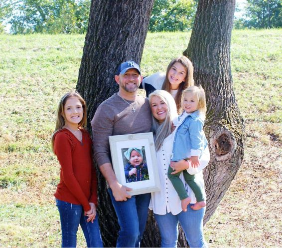 Matt and Ashley Cowan and their daughters