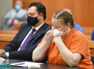 JoAnn Cunningham wiping away snot at her sentencing hearing