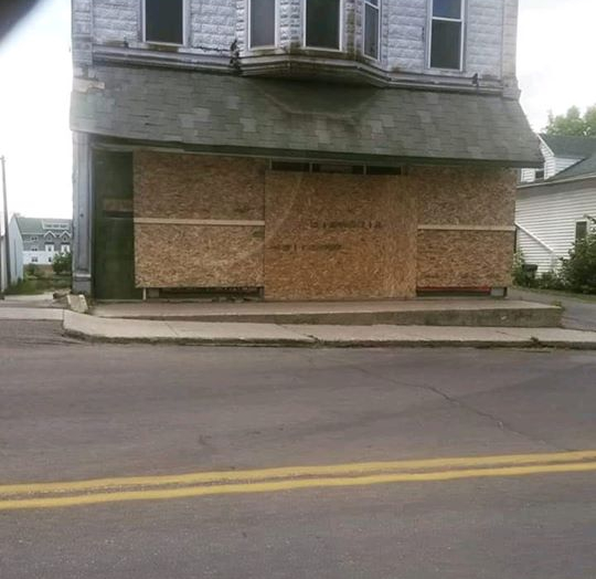 Racist home boarded up in Gouverneur for Treyanna Summerville silent march