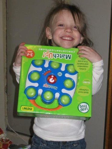 Lauren McConniel smiling and holding a game