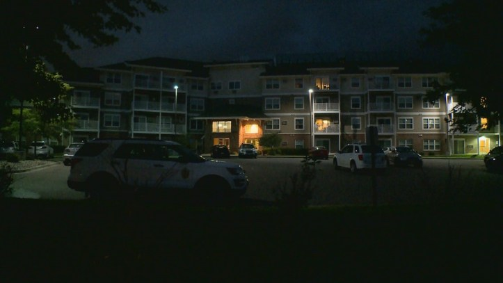 Elk River police at Depot at Elk River Station apartment complex