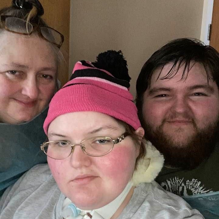 Corena Chambers recovering from her attack (with brother Johnny and mother Lou). (Facebook)