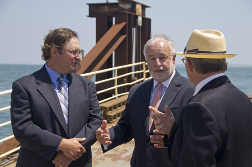 (L-R) Cross Sound Ferry co-owner Adam Wronowski speaks with Congressman Tim Bishop and the ferry's Long Island liason David Kapell near the terminal Tuesday afternoon. (Credit: Paul Squire)