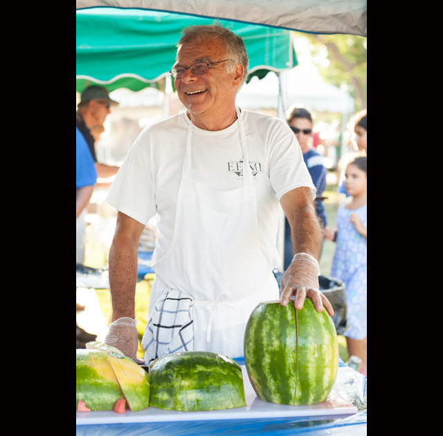 Bob Jester serves up some watermelon.