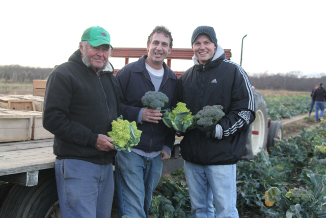 Farmer Gene Wesnofske (left) collaborated with his son, Jason (right), and James Stahl, both Southold High School teachers, on the community service project.