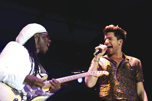 Nile Rodgers and Adam Lambert at last year's AFTEE concert. (Credit: Carrie Miller)