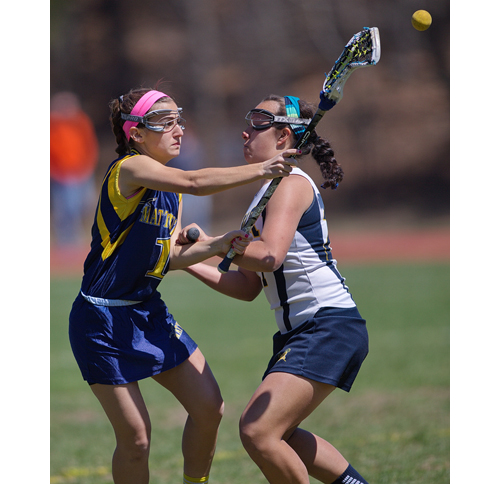 Mattituck's Audrey Hoeg is tightly guarded against Shoreham Saturday. (Credit: Garret Meade)