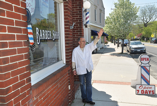 A customer honked his horn as he passed by Al Amore's Tailored Male Barber Shop in Cutchogue earlier this month. (Credit: Grant Parpan)