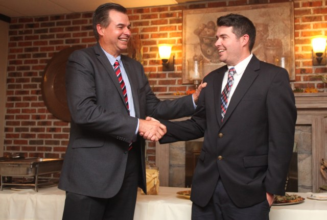 Al, left, and Nick Krupski shake hands before giving their victor speeches at the town Democratic event at Touch of Venice in their hometown of Cutchogue Tuesday. (Credit: Chris Lisinski)