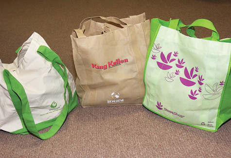 Recyclable grocery bags such as these would largely replace plastic under any local ban. (Credit: Barbaraellen Koch, file)