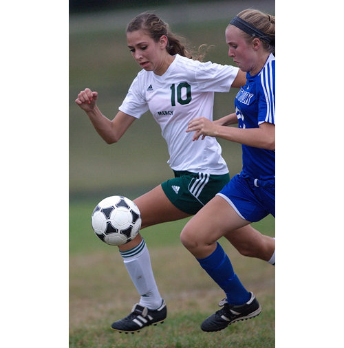 Bishop McGann-Mercy's Dayna Young (10) and Mattituck's Alex Beebe running neck and neck for a ball. (Credit: Garret Meade)