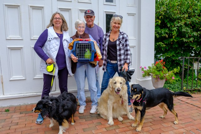 Hawkeye (Parrot), Bailey, Glory and Ranger with their owners Betty and George Capon of Greenport, Holly Weingart  of East Marion and Sharon Bogden  of Greenport. (Credit: Jeremy Garretson)