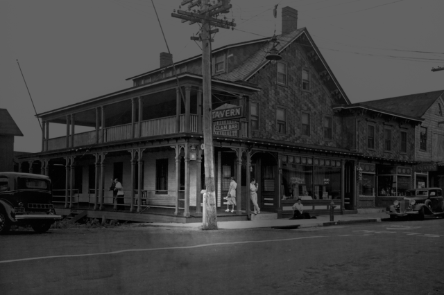 The bright portion of this photo of the outside of what is now Claudio's in Greenport shows the antique mailbox the Post Office plans to remove. Southold Historical Society director Geoffrey Fleming estimated the photo was taken sometime around 1915. (Credit: Claudio family archives)