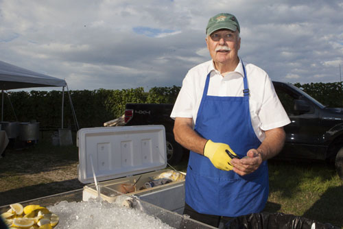 Dean Yaxa of Southold shucks clams and oysters.