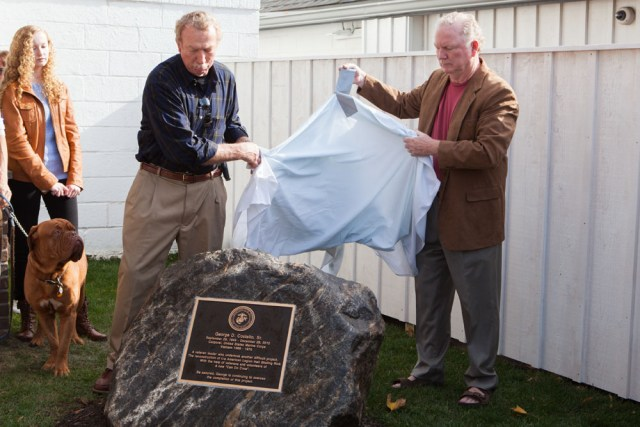 George's brothers John, left, and Tom Costello unveil the memorial plaque. (Credit: Katharine Schroeder)