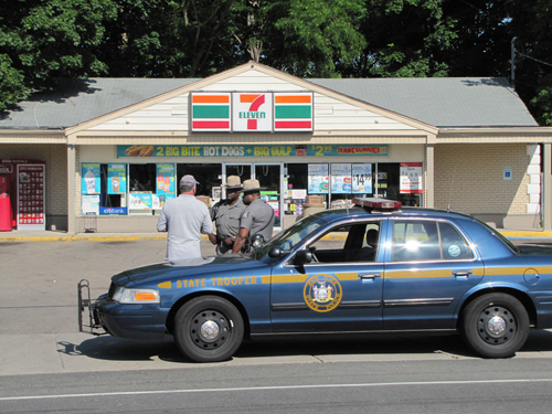 aw enforcement officials outside the Cutchogue 7-Eleven during an immigration sweep in June 2013. (Credit: Cyndi Murray, file)