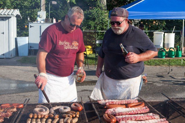 Dave Blados, left, and Tom Smith prepare a snack for the volunteers. (Credit: Katharine Schroeder)