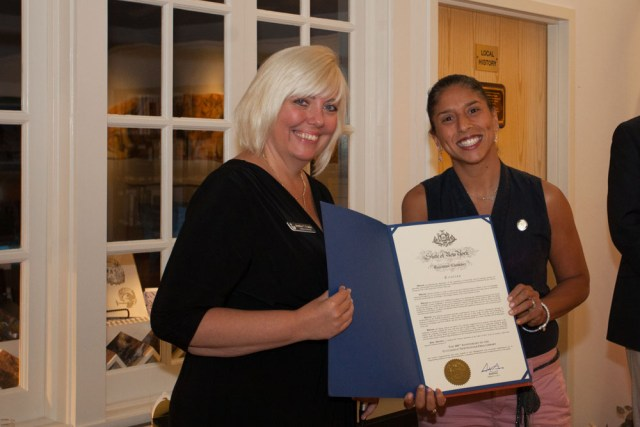 Vanessa Pino Lockel, Suffolk County Representative to Governor Cuomo, presents a proclamation sent by the governor. (Credit: Katharine Schroeder)